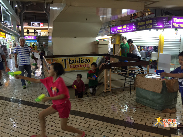 Always good for a surprise: children having a water fight as part of the celebrations for Songkran festival (Thai New Year)