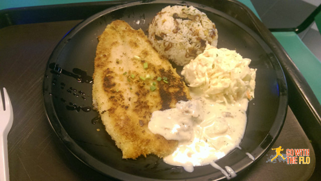 Pan-fried fish with mushroom rice and coleslaw