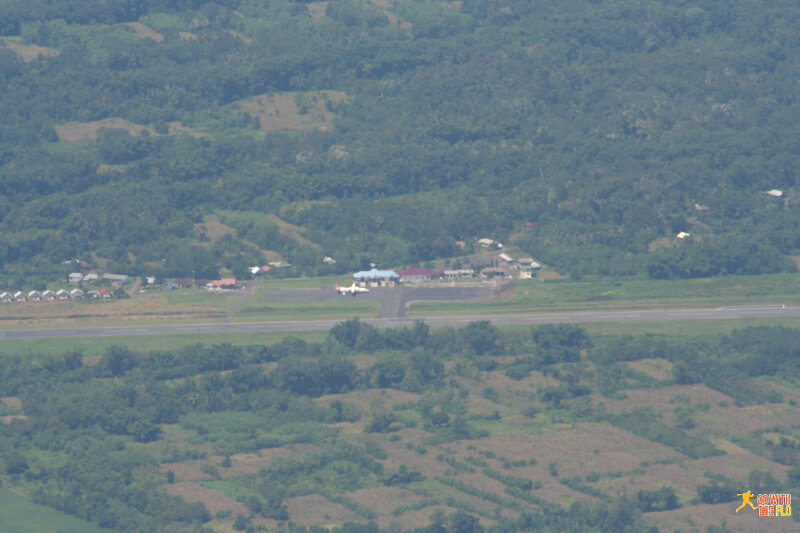 Aerial view from Bajawa (BJW). TransNusa Fokker 50 on the tarmac.