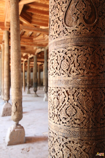 Carvings on wodden pillars inside the Juma Mosque