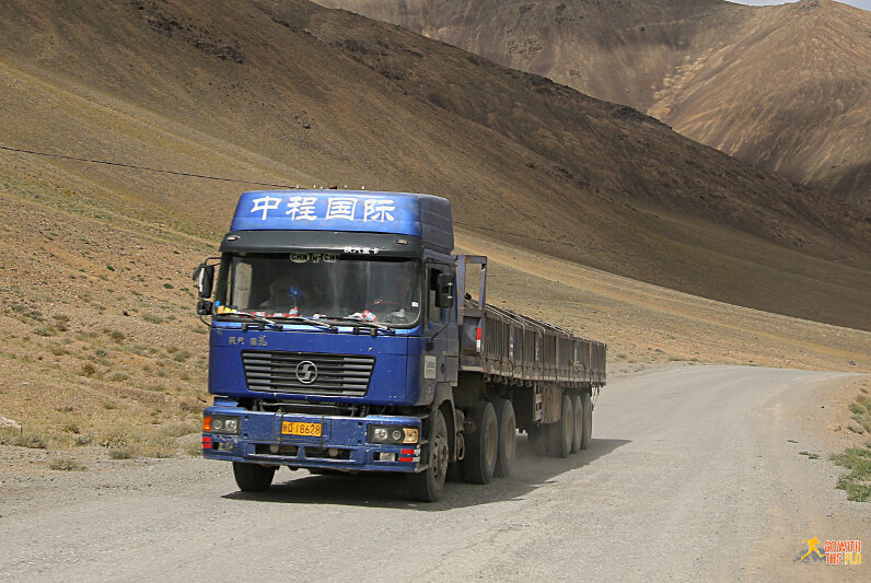 Soon after we started passing about a dozen Chinese trucks