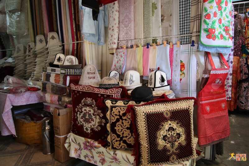 Stall inside Kelechek Bazaar selling traditional Kyrgyz hats