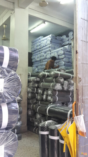 Warehouse full of black and white cloth