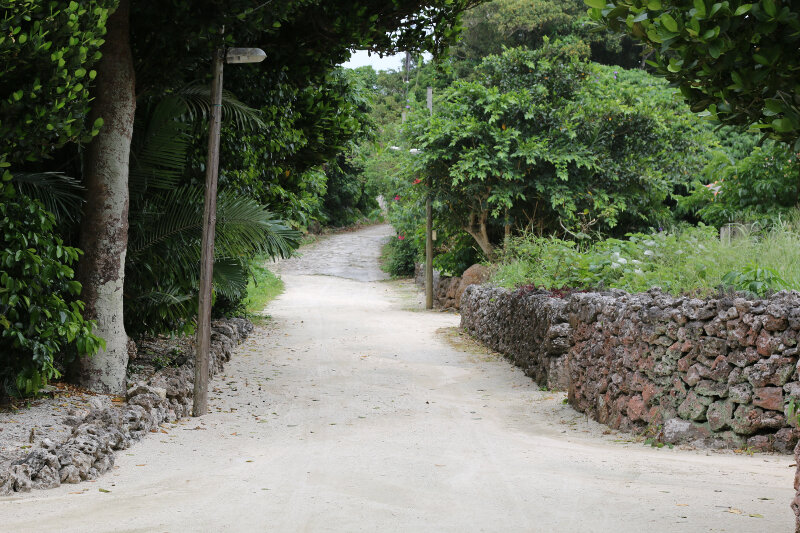 """""""traditional Okinawan"""" houses, stone walls, and sandy streets"""