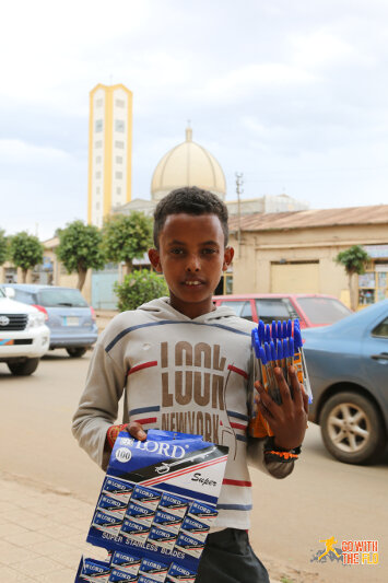 Boy selling pens